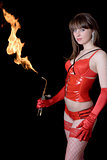 Beautiful young woman in red with a gas torch