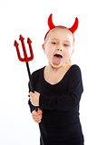 Little girl in devil costume.