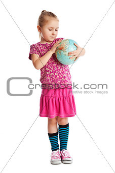 Little girl holding a globe.