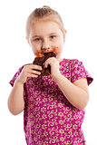 Young girl eating a chocolate bar.