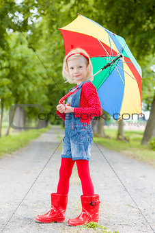 little girl with umbrella in alley