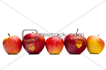 "apple with the words ""I love you"" arranged in a row"