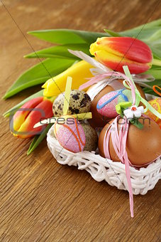 decorated eggs and spring flowers tulips - symbols of Easter holiday