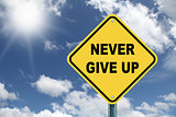 Never give up road sign
