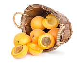 Ripe apricots in a wooden basket