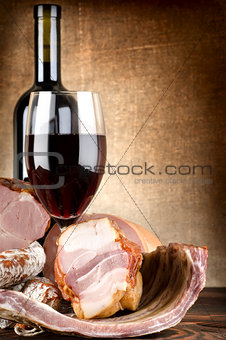 Wine and meat on a canvas