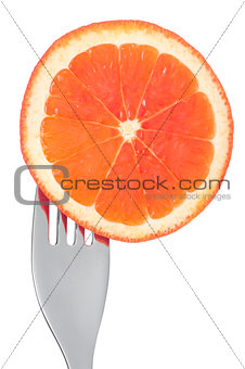 fresh grapefruit slice on a fork isolated