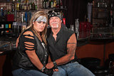 Sad Biker Woman with Grinning Man