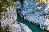 blue river between cliffs