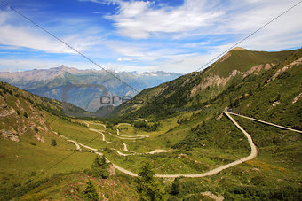 Unpaved road among mountains.