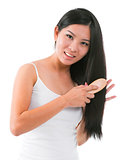 Asian girl combing hair