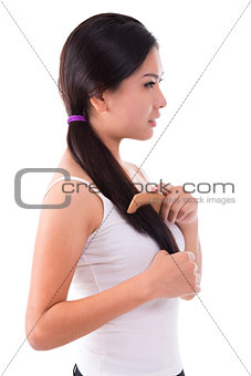 Side view Asian girl combing hair
