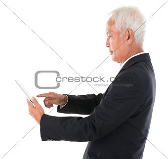 Asian Chinese boss using tablet computer