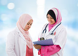 Two Southeast Asian Muslim medical doctor