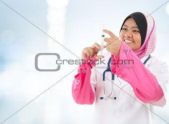 Muslim doctor filling the syringe