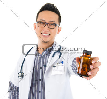 Asian medical doctor holding a bottle of pills