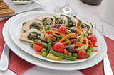 Chicken roulade with spinach and mushrooms with vegetables