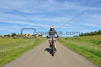 Mountain biker on a road