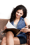 Indian smiling female studying  file