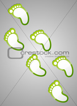 Green footprints on grey background.