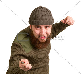 bearded man with a knife on a white