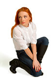 beautiful red-haired girl in a white blouse 
