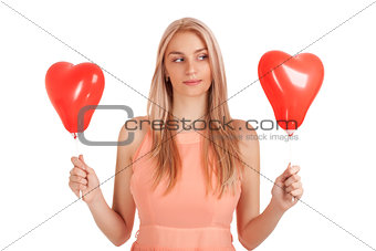 Young woman choosing one of balloons