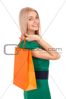 Beautiful blond woman holding shopping bag