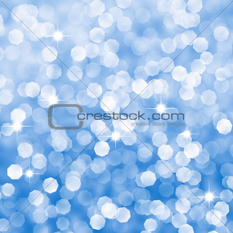 Abstract blue sparkles defocused background