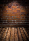 vintage room with brick wall and rough wooden floor