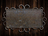 Vintage metal plate  on old oak door