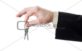 Hand of businessman holding set of keys isolated on white