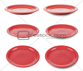 Set of red round plates or dishes isloated on white with clippin