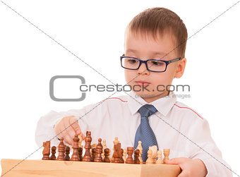 Serious child playing chess