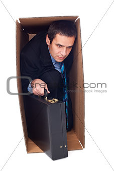 Businessman inside of a cardboard box