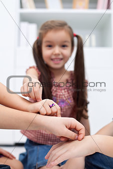 Children playing with fingers