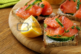 canape sandwiches with salmon and cucumber