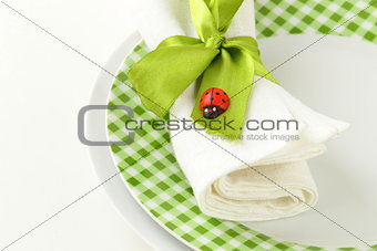 Spring Easter table setting with green ribbon