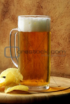 light beer and potato chips on a wooden board