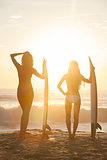 Beautiful Bikini Women Surfers &amp; Surfboards At Beach