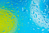 Water droplets on blue and green abstract background