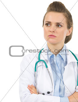 Portrait of medical doctor woman looking on copy space