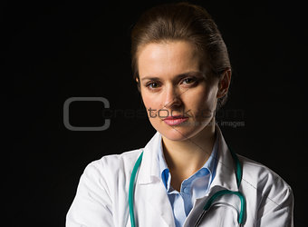 Portrait of confident medical doctor woman isolated on black