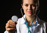 Medical doctor woman using stethoscope isolated on black