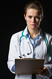 Portrait of confident medical doctor woman with clipboard