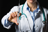 Closeup on syringe in hand of medical doctor woman
