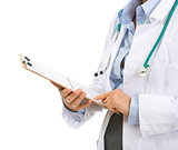 Closeup on medical doctor woman checking clipboard