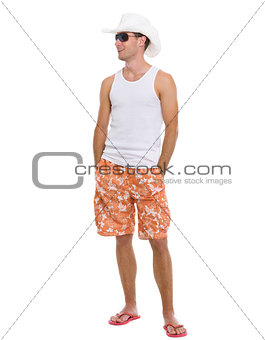 Full length portrait of happy young man looking on copy space