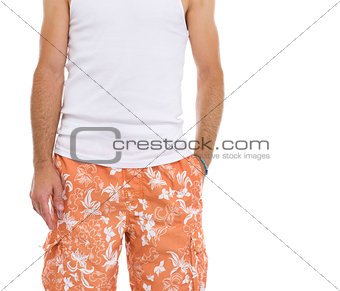 Closeup on young man in shorts