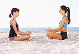 Taking a seaside yoga class